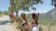Two young girl relaxing in the mountains. 4K 30fps ProRes (HQ) Stock Footage