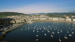 Aerial Above the Boats in Concha Bay with San Sebastian Buildings, Spain Stock Footage
