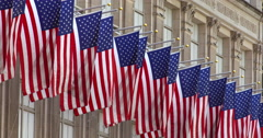 American flags in a row slowly flap in the breeze in New York City Stock Footage