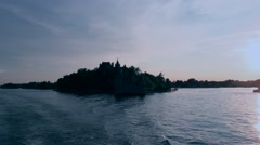 Sailing away from Boldt Castle on the St. Lawrence River Stock Footage