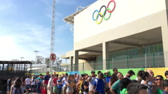 Line of spectators waiting to enter Olympic Park on opening day Rio 2016 4k Stock Footage