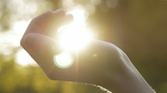 Close-up of opening the hand with the sun shining over the palm Stock Footage