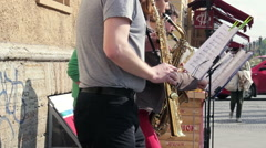 Close Up of Saxophone Quintet Playing Melodies on the Street Stock Footage