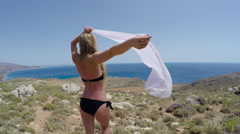 Young blond girl resting on the sea. Greece, Crete. 4K 30fps ProRes (HQ) Stock Footage