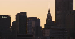 Chrysler Building among other New York City skyscrapers during sunset Stock Footage