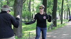 Woman Practicing Self-defense Trainings Defending Herself by Knife Stock Footage
