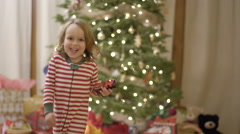 Kid Looks Up At Christmas Tree, Back To Camera, Then Runs Toward Camera, Smiles Stock Footage