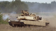 Tank drives on the battlefield Stock Footage
