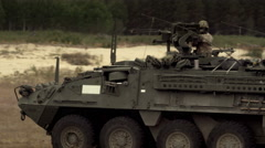 Soldiers in military vehicle Stock Footage
