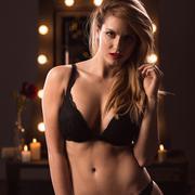 Sexy provocative girl undressing Stock Photos