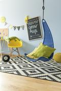 Unconventional place to sit in child room Stock Photos
