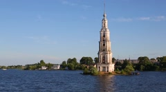 Famous old bell tower standing in the Volga River in the Kalyazin city in Russia Stock Footage