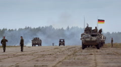 Soldiers, vehicles in military base Stock Footage