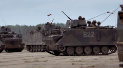 Armored vehicles with soldiers in the base Stock Footage