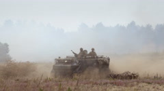 Armored military vehicle in the field Stock Footage