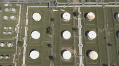 Aerial view of oil refinery storage tanks Stock Footage