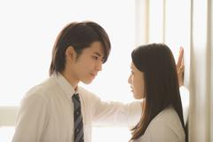 Japanese high-school students in a romantic moment in the school corridor Kuvituskuvat