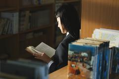 Japanese high-school student in the school library Stock Photos