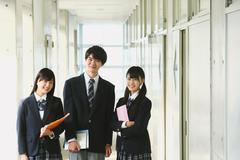 Japanese high-school students in school corridor Stock Photos