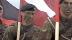 Soldiers walk and hold country flags Stock Footage