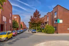 Street with Modern family houses in a suburban neighborhood Stock Photos