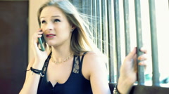Punk girl talking on cellphone and looking very irritated Arkistovideo