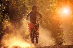 Man riding motorcycle in motor cross track use for people activities and leis Stock Photos