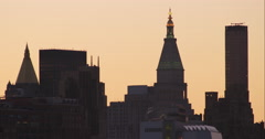 Group of New York City skyscrapers old and modern during sunset Stock Footage