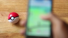 Gamer Plays Pokemon Go on at Home Stock Footage