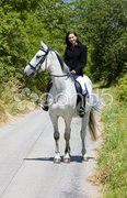 Equestrian on horseback Stock Photos