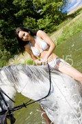 Equestrian on horseback riding through water Stock Photos