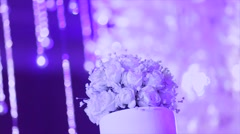 Wedding cake decorated with flowers at wedding ceremony Stock Footage