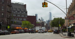 New York City street traffic moving towards World Trade Center Stock Footage