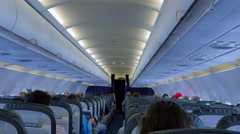 4K Airplane Interior, Passenger Aircraft, Seats and Isle, Dim Light Stock Footage