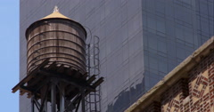 Water tower among skyscrapers in New York City Stock Footage