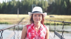 Young american cowgirl woman portrait outdoors. Beautiful natural woman walking Stock Footage