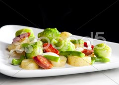 Vegetables mixture with sausage and potatoes Stock Photos