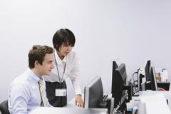 Multi-ethnic business people in the office Stock Photos