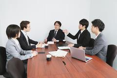 Multi-ethnic business people in a meeting room Stock Photos