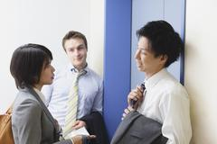 Multi-ethnic business people leaving the office Stock Photos