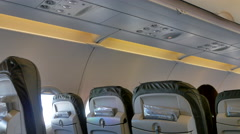 4K Airplane Cabin Interior, Passenger Seats and Overhead Compartments, Windows Stock Footage