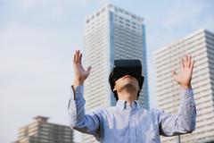 Japanese man using virtual reality device Stock Photos