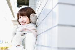 Attractive Japanese woman with muffler on a Winter sunny day Stock Photos