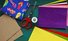 Flat lay view of Felt sheet and scissors. Stock Photos