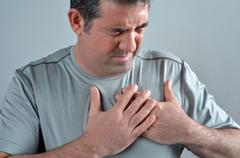 Man having acute pain in a his chest Stock Photos