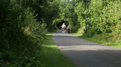 People Cycling on Cycle Path Stock Footage