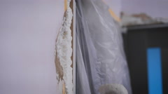 Hand coating wall of plaster Stock Footage