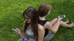 Teen girls spending summer day with mobile phones Stock Footage