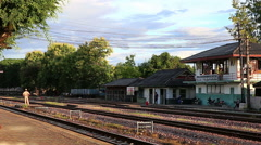 Officer waiting for train that will arrive at Lampang train station. Stock Footage