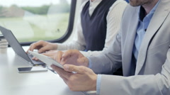 Young professional traveling on the train on a business trip Stock Footage